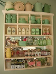 update cupboard oct 08 by bugsugarbabylove, via Flickr: Jadeite, glassware, enamelware etc...
