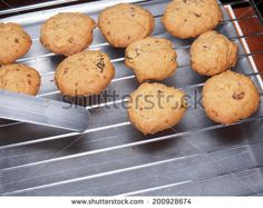 Cashew nut cookies on steel grid after bake in oven - stock photo