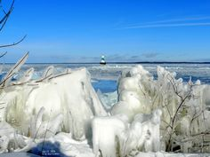 Ice along the shore by The Water Plant, and lighthouse