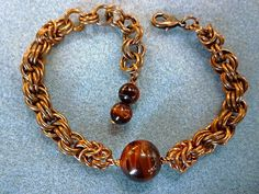 Red tigers eye copper chainmaille bracelet by EileensBeadedJewelry, $24.00 #copperbracelet #chainmaille #tigerseyebracelrt