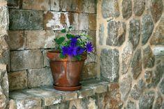 Mediterranean home indoor stone wall & flower decoration concept http://www.casademar.com