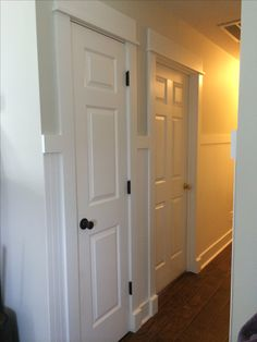 Classic farmhouse/cottage trim work...no mitering, using 1x6's for baseboard, 1x4's for sides of door with a 1x2 topped with a 1x6 for the tops of the doors...white beadboard with a 1x4 to trim it on top.... Craftsman Trim, Craftsman Interior, Interior Barn Doors, Interior Door Trim, Craftsman Style, Moulding, Moldings And Trim, Crown Molding, Baseboard Styles