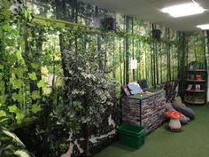 Another installation of digitally printed wall paper with live plants added for extra affect .