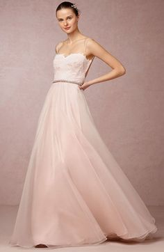 9. BHLDN ($3,150) Leanne Marshall designed this organza blush wedding gown exclusively for BHLDN . With tiny spaghetti straps and a lace corseted top, giving way to a lace-edged open back; ethereal layers of ivory silk organza float over blush silk for a touch of soft color. Truly a dreamy blush wedding dress.
