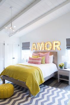 Yellow and red bedroom for teenager, gray chambray rug, marquee lighting above bed and vaulted ceiling | Alexander Designs