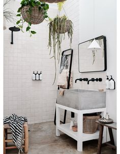 Boho Home Decor concrete and natural tile with hanging planter baskets in a styled rental cottage.Boho Home Decor concrete and natural tile with hanging planter baskets in a styled rental cottage Interior Simple, Home Interior, Interior Livingroom, Cosy Home, Contemporary Barn, Small Barns, Bright Homes, The Design Files, Wet Rooms
