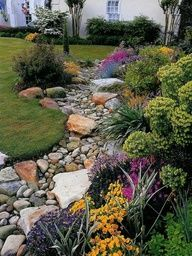 Beautiful! Dry stream bed for natural drainage ... side yard to front? through the front yard into the ditch?????????