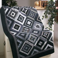 Quilt by Lynda Faires.Easy strip piecing makes this striking quilt a great weekend project. Use a collection of graphic prints in black-and-white to create contrast and interest.