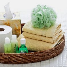 Round, low basket for guest toiletries