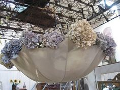 Bedsprings on the ceiling and an old umbrella filled w/hydrangea. Now, that's different.