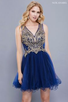A gorgeous V-neck embroidered bodice dress with a short ruffle tulle skirt.  Comes f825c981aff0