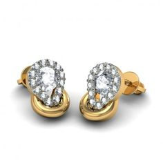 http://www.bluestone.com/earrings/diamond-earring-in-18kt-yellow-gold~397.html    Understatedly glamourous, this 18 Kt gold and diamond stud set is sure to look perfect for both night and day wear.