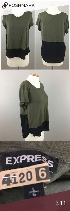Express Cotton Olive Green Black Oversize T Shirt Express Cotton Olive Green Black Oversize T Shirt. Size large. Thank you for looking at my listing. Please feel free to comment with any questions (no trades/modeling).  •Fabric: Cotton Blend  •Bust:  •Length:  •Condition:    25% off all Bundles or 3+ items! Reasonable offers welcome. Visit me on INSTA @reupfashions. Express Tops Tees - Short Sleeve