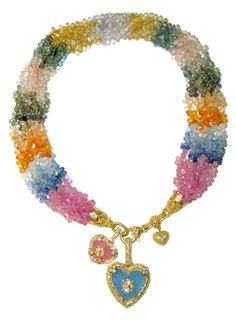 The beads are colored sapphires and the charms are colored quartz with diamonds in gold. (Via 1stdibs.)
