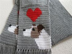 Jack Russell / Parsons Terrier scarf. This is a handmade,original crochet design scarf in our love my dog series. Weloom knit the length of the scarf with grey and then Icrochet ared heart and white and brown Jack Russell terrier on each end. The Jack Russells have dark brown ears and a black eye and nose. The terriers are crocheted to face opposite directions when the scarf is worn.    All loose ends are sewn in and this is a very well made, soft, thick scarf. The last photograph shows ...