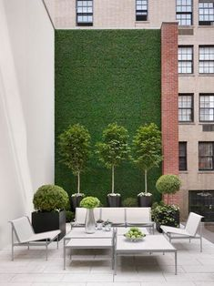 when your garden is a balcony somewhere. grass wall too hard? how about some astroturf?! great alternative to bad view, no privacy. (photo by nikolas koenig)