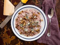 This classic risotto dish from the Veneto region of Italy is made by cooking shredded radicchio into the rice, along with wine, cheese, and shallots. This version is topped with a combination of toasted walnuts, thyme, and blue cheese.