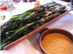 Seasonal in the northern parts of Spain, Calçots are a type of spring onions which are barbarqued over the fire and then dipped into a Romesco sauce and into your mouth!