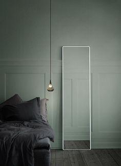 Minimal, moody sage green bedroom