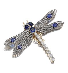 GEM-SET AND DIAMOND BROOCH.  Designed as a dragonfly, the body and wings set with circular-, rose-cut diamonds and oval sapphires, to an oval sapphire thorax and cabochon sapphire eyes.