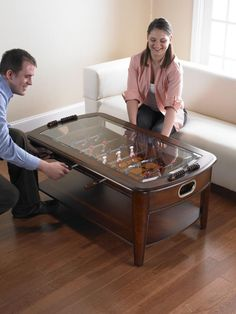 Chicago Gaming Signature Foosball Coffee Table (8% savings): The Signature Foosball Coffee-Table is suitable for both a game room or living room. The rich solid hardwoods blend into the environment, and the elegant frame is fit for any setting. This is more than just a foosball table, it is an impressive conversation piece and center piece. This table is made with quality, fine furniture grade craftsmanship, and features attractive accents and detailing.