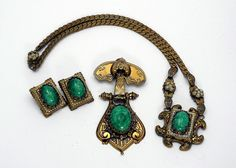 Vintage Jewelry Set, unmarked, brass, green glass cabochon stones, no-hole pearls.  Necklace, clip earrings and hinged brooch with ring for bail.  Heavy, substantial, seems well made.  Do you know anything about it?