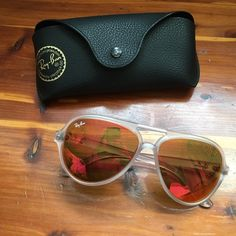 Rayban sunglasses NEW WITHOUT BOX. CASE INCLUDED. The Ray-Ban CATS 5000 Classic Unisex Sunglasses feature Aviator like design with a twist. Clear matte white frames. Pink/orange lens. Case included. Ray-Ban Accessories Glasses