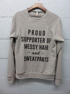 AH, THIS COMES IN A SWEATSHIRT AS WELL!! These are so soft!! sweatshirt (French terry) proud supporter of messy hair -and- sweatpants Fabric: 36% cotton 34% spun poly 19% rayon 11% polyester Made In: made in usa Stock Availability: In Stock HANG TO DRY!!