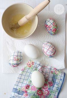 Use paper napkins and egg whites to decorate eggs for Easter.