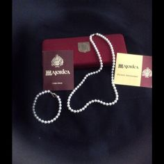 """Majorica Cream Pearl Set MAJORICA pearls are MAN-MADE (imitation) pearls made in Majorca, Spain.  This set has a CREAMY (NOT white!) iridescent coloring and closely resemble real pearls but are actually made out of glass, dipped in a special hemage and polished by hand.  They are considered """"impervious to discoloration, chipping and peeling"""".  (NOT to be confused with a poor imitation called """"Majorca"""" which is spelled differently).  On their web site, the bracelet is priced at $110 and the…"""