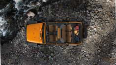 Jeep® Wrangler Unlimited Rubicon shown in Dozer with available premium leather-trimmed seats. Properly secure all cargo.