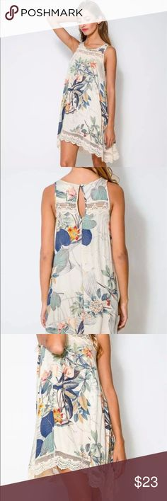Romantic floral dress Crochet lace trim detail. Very thin polyester. One button back neck closure. Just above knee length. First photo is stick photo. Other photos are of the actual dress Lizzy & Jane Co Dresses Midi
