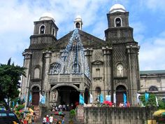 TWIN DOMED TOWERS. Unique and easily noticeable in Tondo Church is its twin bell towers, and a third small bell tower on its roof. Photo from Sto. Niño de Tondo Church