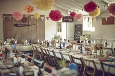 Pom Poms Bunting Decor Family Friendly DIY Village Hall Wedding http://www.novaweddingphotography.co.uk/