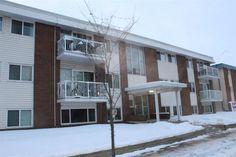 Condo in Edmonton $104649.00  #304 10920 124 Street Corner Unit, Condo, Garage Doors, Street, Building, Outdoor Decor, Buildings, Roads, Construction