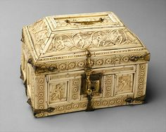 Casket with Warriors and Dancers ~ 11th century ~ made in Constantinople ~ Byzantine ~ iron, bone, gilded copper mounts ~ The erotes play instruments such as drums, cymbals, and tambourines. On the back and right side panels of the box, the erotes rush confrontationally toward one another with weapons. There is an element of joviality and satire found in this imagery that is only seen in such objects that were part of the private life of the Byzantine citizen.