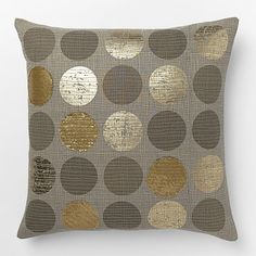 Go for gold. The Metallic Circles Pillow Cover's pattern of gold foil polka dots on a 100% cotton canvas base brings a light sheen to the sofa.