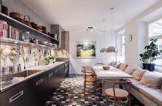 Kitchen, a home in stockholm. Wienerstole, rustikt spisebord og lang indbygget bænk.