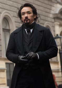 John Cusack as Edgar Allen Poe (Is it weird that I want to sit on his face?)