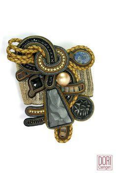 Dori's Opera bracelet is all about making a big statement in subtle colors!   #doricsengeri #couturejewelry #statementbracelet #falltrends #wearableart #designerjewelry #oversizedbracelet