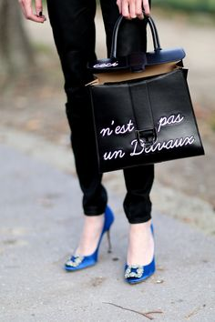 A limited-edition Delvaux leather satchel with Manolo Blahniks on the side.                  Source: IMAXTREE / vincenzo grillo