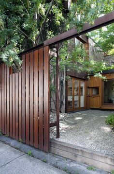 wood fence, vertical slat, modern Looks like the vertical version of what you are considering. I would hope for slightly wider gaps. Nice design though.