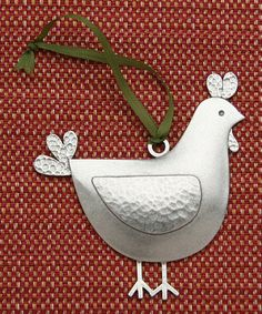 Beehive kitchenware chicken ornament. Add an heirloom-quality touch to a special tree or decorating project with this handcrafted ornament. Featuring a darling chicken design and elegant pewter construction, it makes an ideal keepsake.