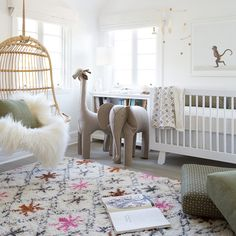 Jungle inspired nursery - just switch out the rug for a pop of color for your little boy or girl | Hanging Rattan Chair & Hudson Crib via Serena & Lily | Image via Erin Fetherston