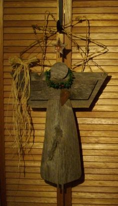 Angel I made out of old barn board with barb wire star
