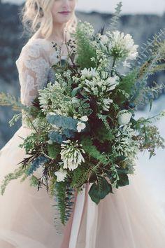 lush green bouquets - photo by Lilly Red Creative https://ruffledblog.com/lake-tahoe-beach-wedding-inspiration