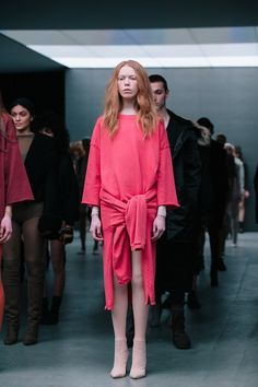 Coral pink sweater at Kanye West x adidas AW15 NYFW. See more here: http://www.dazeddigital.com/fashion/article/23612/1/kanye-drops-a-new-track-with-sia-listen-here