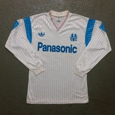 """VINTAGE Olympique Marseille Adidas Soccer Home Jersey '90-'91 /  size L Large / made in france / long sleeve shirt / 1990-1991     TAG READS;  Size L Large    MEASUREMENTS;  LENGTH from top of collar to bottom of garment; 29""""  CHEST armpit to armpit flat across; 19""""  Compare these measurements to a piece of clothing you currently wear to make sure it fits.    Jersey is MADE IN FRANCE.   It is 72% Polyester 28% Triacetate    CONDITION;   Pre-owned/vintage. Shows mostly minimal wear. No known…"""