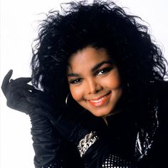 JANET JACKSON - 1986 Janet asserted herself as someone in Control of her image with her trendsetting big hair and all-black ensembles.