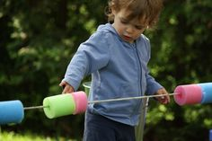 Such a cool use for pool noodles - hanging on a rope for outside play... abacus!